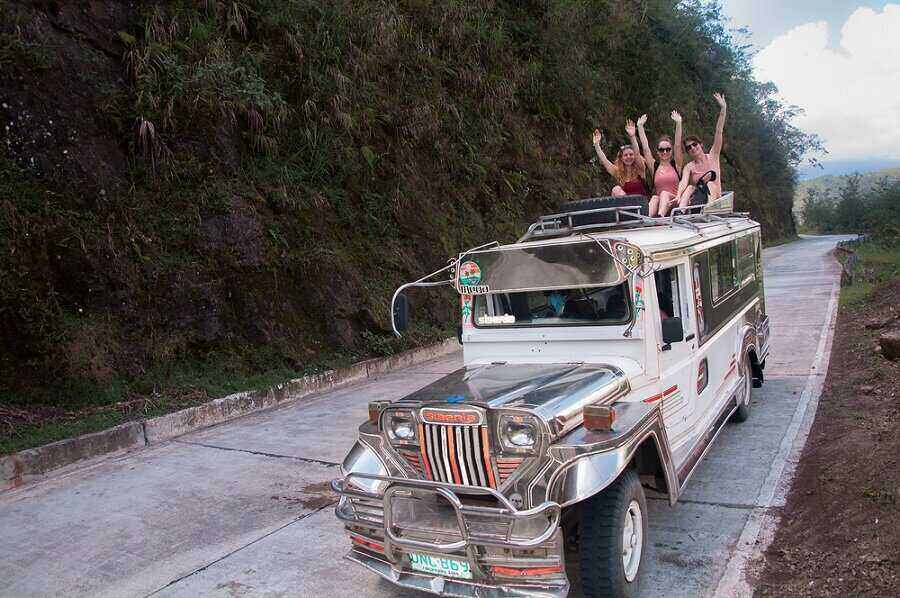 tourists enjoying the jeep tips when traveling the philippines
