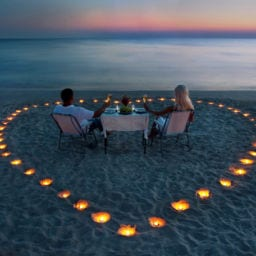 couple having a romantic dinner on the beach