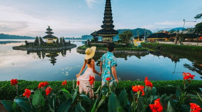 couple holding hands in bali