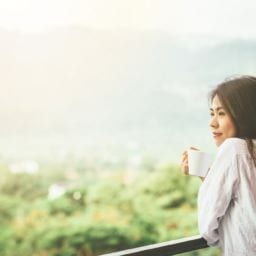 girl enjoying coffee at home