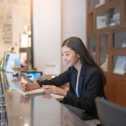 asian hotel receptionist busy working