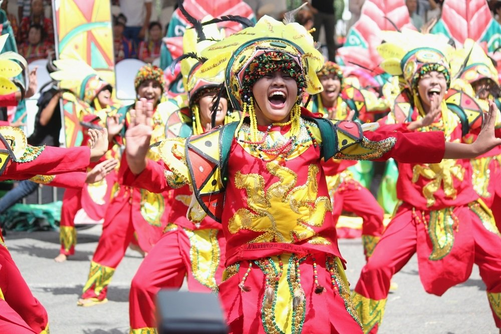 happy street dancers during the kadayawan festival