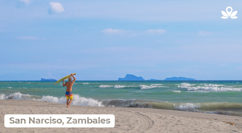 a man going to surf in zambales