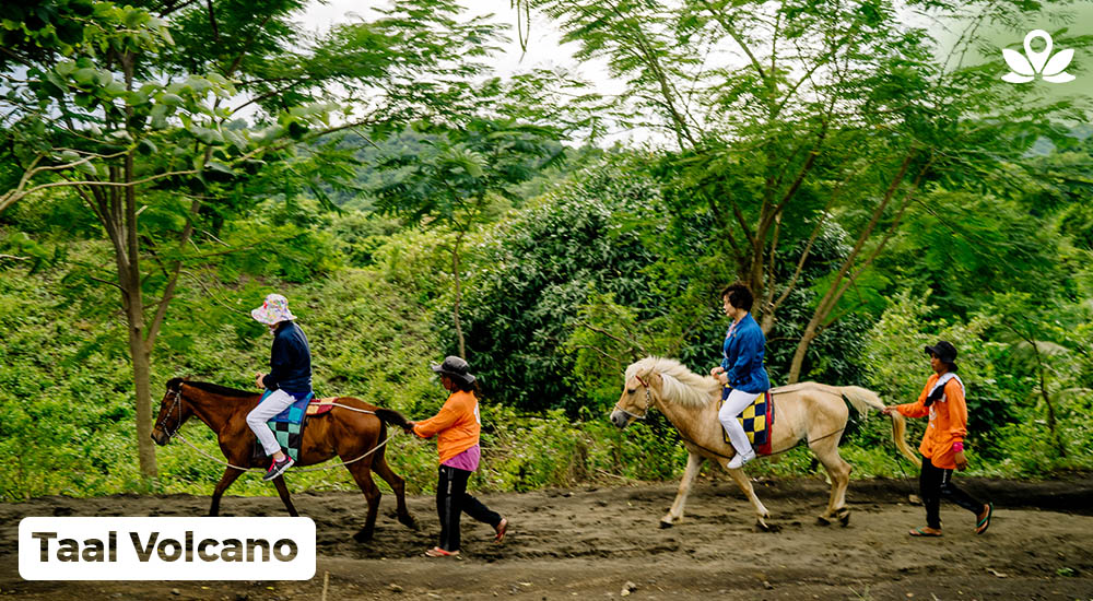 tourists horseback riding in taal volcano in batangas