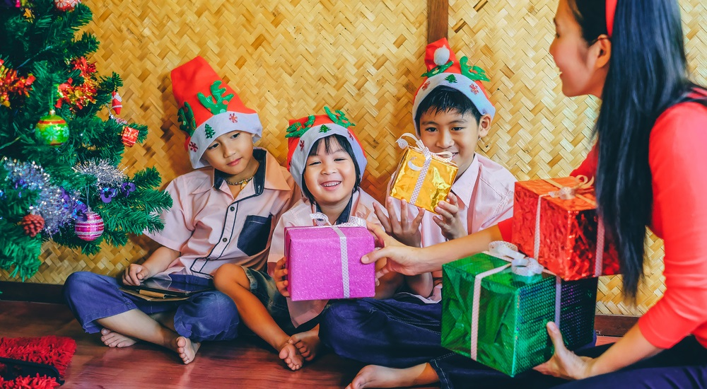 happy kids receiving christmas gifts