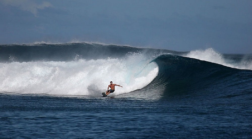 a man surfing in siargao