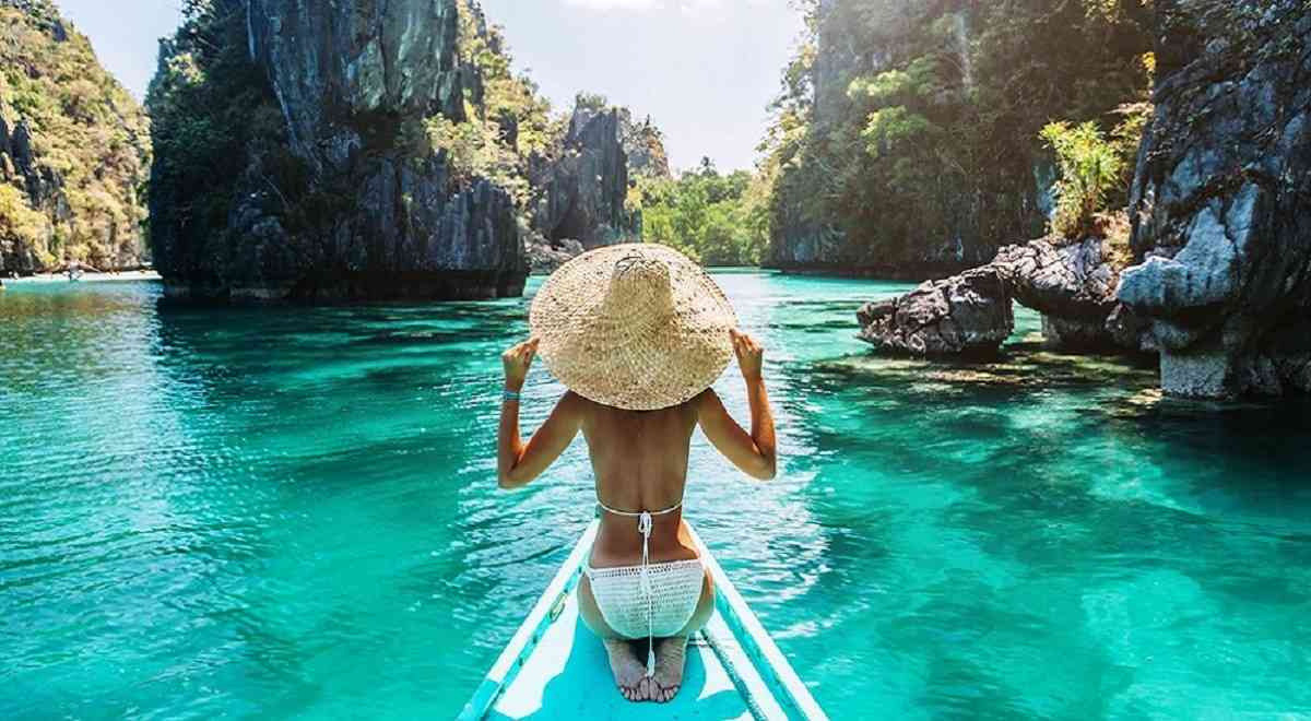 an island girl in el nido palawan work from beach in the philippines
